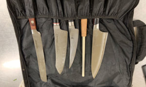 A selection of chef's knives including a steel hone.